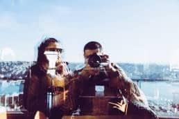couple taking selfie in reflection, blurry but still better than nothing
